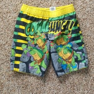 Boys size 5 ninja turtles swim trunks.